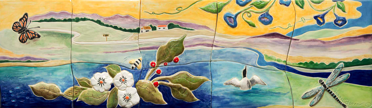 ceramic high relief tiled frieze end panel with lake, flowers, loon, butterfly, dragonfly, rolling hills in background